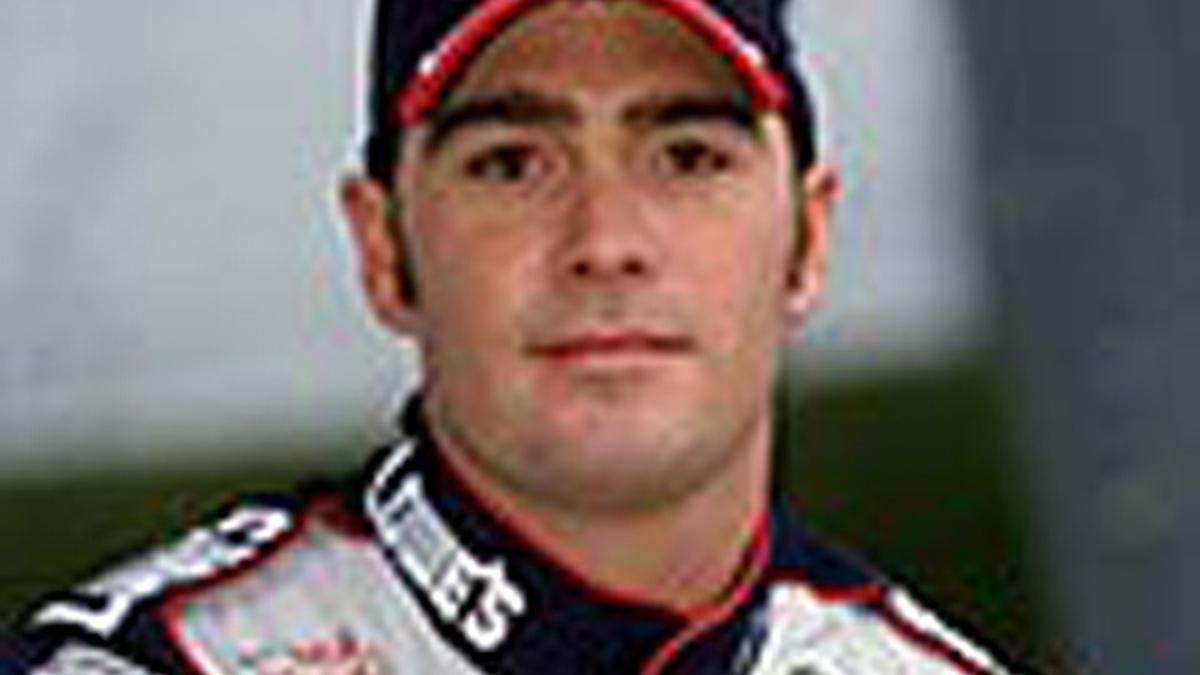 Johnson Leads Rain-Shortened Indy Test