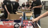 Johnson prepares care packages for troops