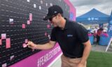 Johnson paints the wall pink for breast cancer awareness