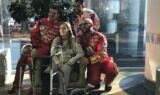 Pit crew athletes visit Levine Children's Hospital
