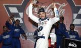 Check it out! Larson celebrates history-making win at Charlotte
