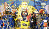 Johnson hits Victory Lane at Kansas