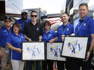 Bowman presents donation to Nationwide Children's Hospital along with some very special artwork