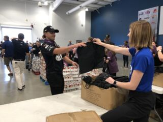 Organizations join to pack meals for children