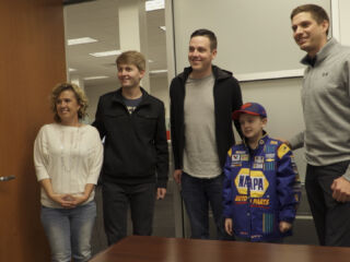 Hendrick Motorsports hosts young fan for special day on campus