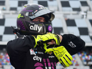 Johnson captures win in rain-shortened Clash