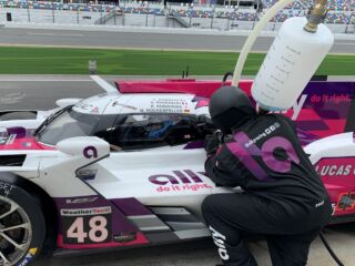 Assembled Hendrick Motorsports pit crew ready for challenging Rolex 24