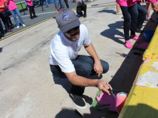Johnson helps paint the wall pink