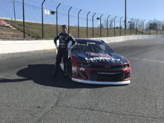 Byron displays 2018 Liberty University firesuit and Chevy