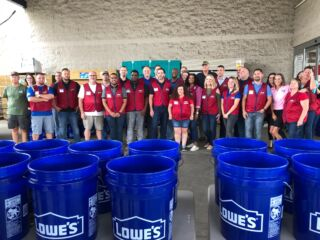 Johnson donates truck full of supplies, helps pack buckets for hurricane relief