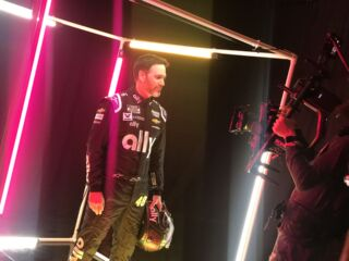 Teammates don fresh firesuits at Charlotte media event