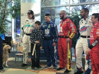 Pit crew athletes visit Levine Children's Hospital