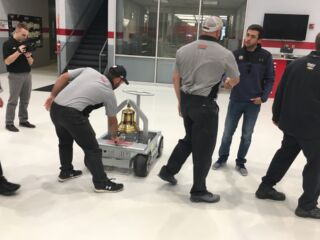 Elliott brings Victory Bell to celebrate two Round of 12 wins with teammates