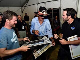 Johnson, Petty share special moment -- and autographs