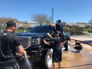 Pit crew surprises fans